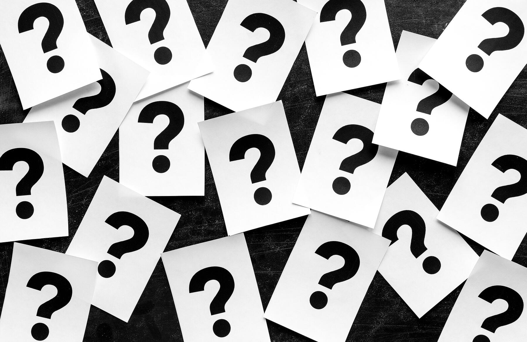 bold-black-question-marks-on-paper-cards-2BGSDX7