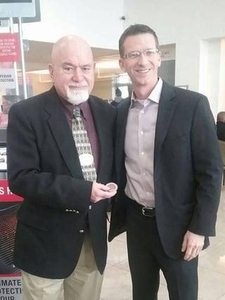 Bill DeTellis reciving challenge coin from David Stringer