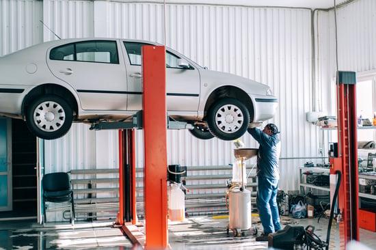 car-lifted-on-car-lift-for-routine-maintenance-F5DB9EQ