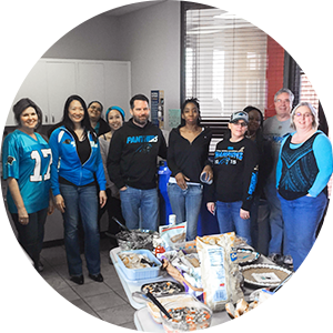Employees posing at tailgate party