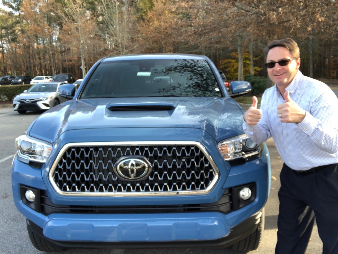 Toyota Jeff next to a tacoma