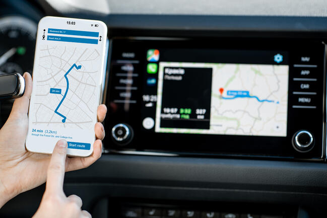 smart-phone-with-navigation-app-in-the-car-JKGK92M