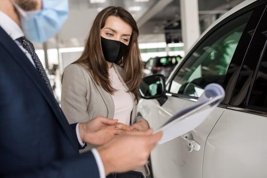 woman dealership customer in mask