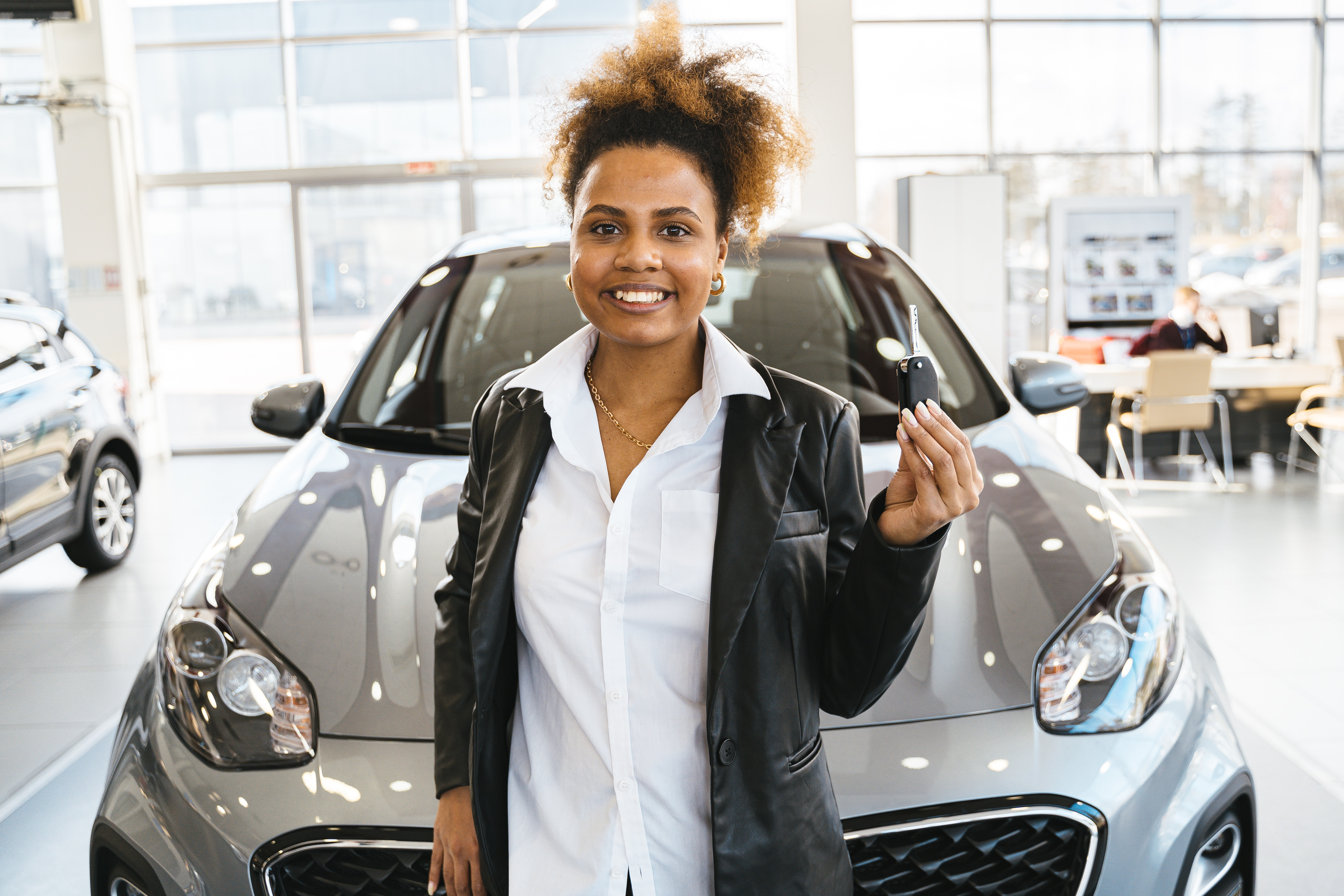 woman in dealership with car fob